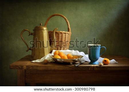 Still life with apricots and a coffee pot (textured for artistic effect) - stock photo