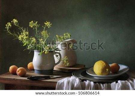 Still life with apricots and a lemon - stock photo