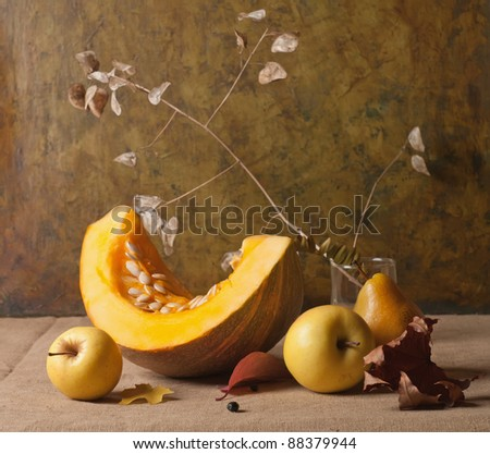 Still life with autumn vegetables and fruits on burlap background - stock photo