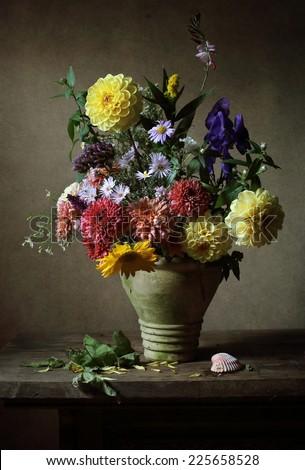 Still life with beautiful autumn flowers - stock photo