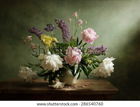 Still life with beautiful peonies - stock photo