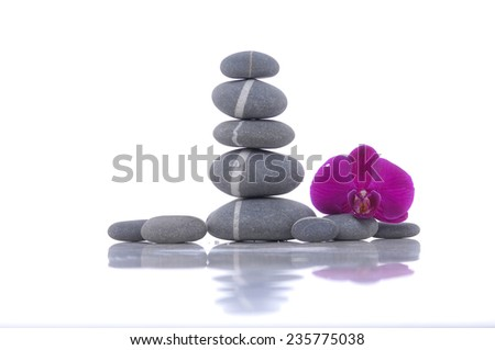 Still life with Beautiful red orchid and stacked stones  - stock photo
