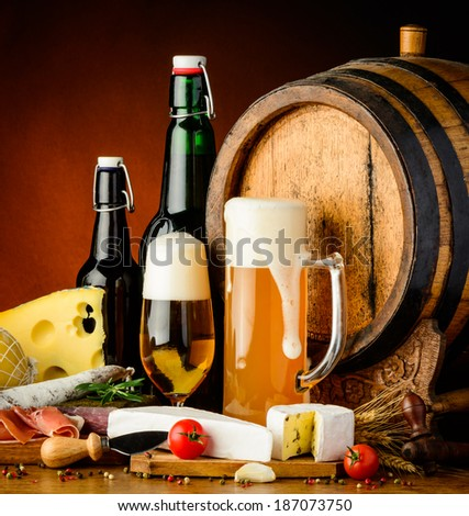 still life with beer traditional food and wooden barrel - stock photo