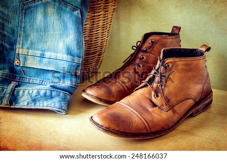still life with boots and jeans on wooden