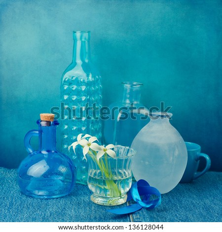 Still life with bottles in blue tones - stock photo