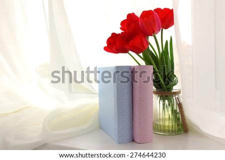 Still life with bouquet of fresh tulips on windowsill background - stock photo