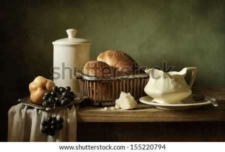 Still life with bread and porcelain - stock photo
