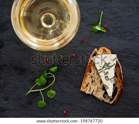 Still life with bread, cheese and glass of wine