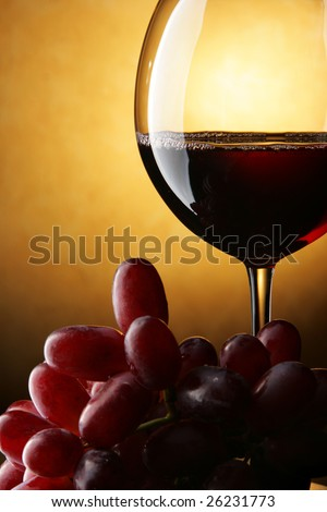 Still life with bunch of grapes and red wine - stock photo