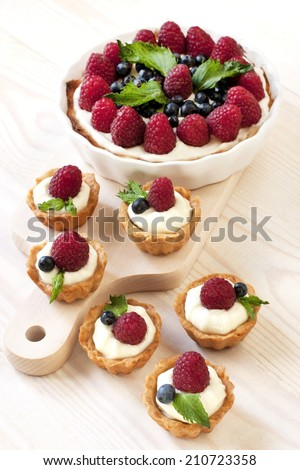 Still life with  cake and  fresh berries - stock photo