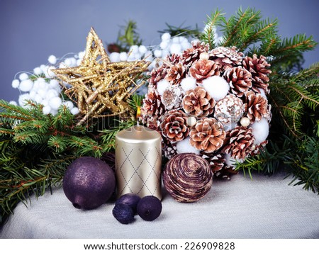Still life with candle and christmas decorations - stock photo