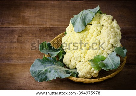Still life with Cauliflower on wooden background - stock photo