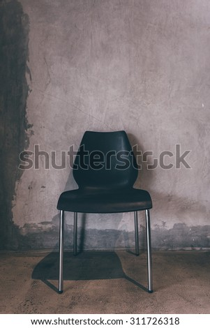 Still life with chair and old wall