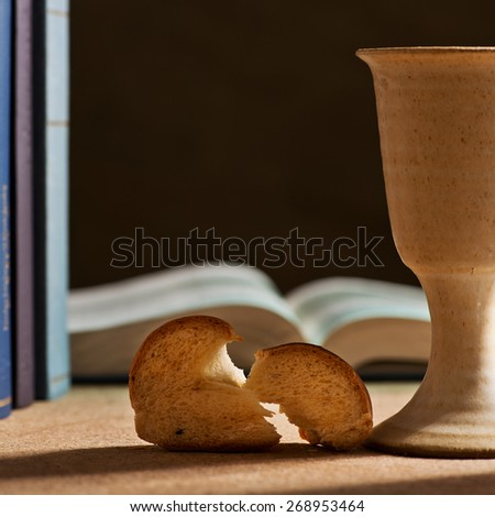 still life with chalice of wine and bible - stock photo
