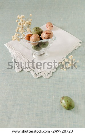 Still life with chocolate Easter eggs and flowers  - stock photo
