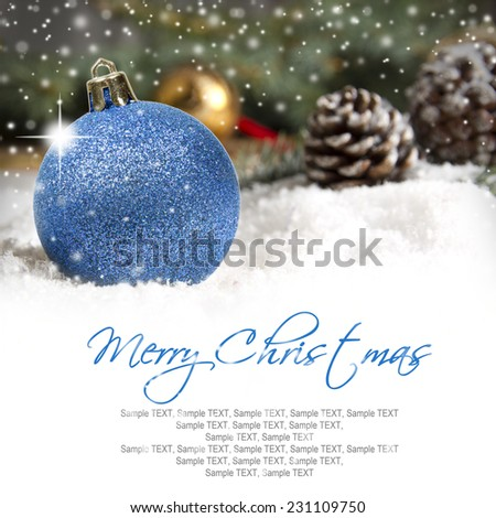 Still life with Christmas ball and cones covered with snow with white space for the text