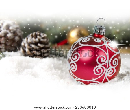 Still life with Christmas ball and cones covered with snow with white space for the text - stock photo