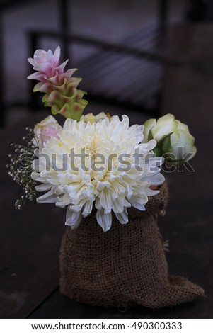 still life with chrysanthemums flower on hessian. Dramatic. Selective focus.