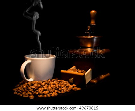 still life with coffee on a black background - stock photo