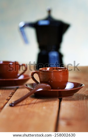Still life with coffee pot and cups - stock photo