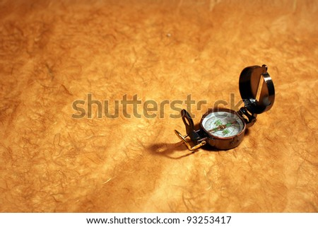 Still-life with  compass, rope and leather map  over old paper. Travel or vacation concept - stock photo