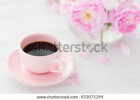 Still life with cup of coffee and  bouquet of roses. Selective focus. Shallow depth of field.