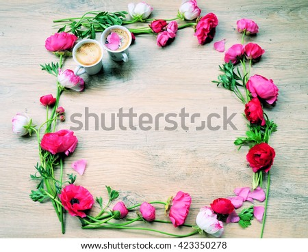 Still life with cup of coffee and flowers a wooden - stock photo