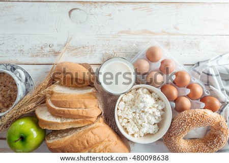 still life with dairy products, milk, eggs, bread