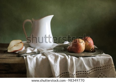 Still life with drapery and red pears - stock photo