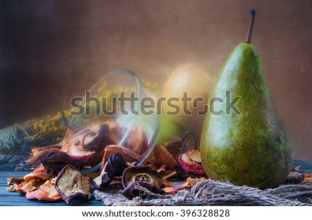 Still life with dried fruits from apples and pears thorough inspection - stock photo