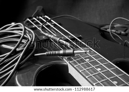 still life with electrical guitar and jacks; black and white