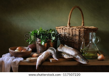 Still life with fish and onions - stock photo