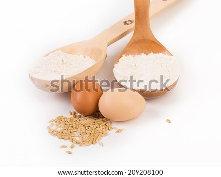 Still life with flour and eggs. Isolated on a white background.