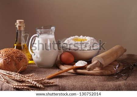still life with flour, bread. milk and wheat