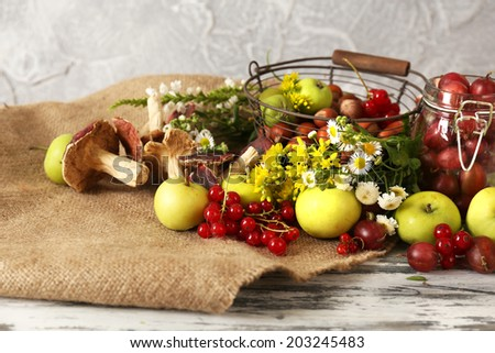 Still life with flowers and fruits on table