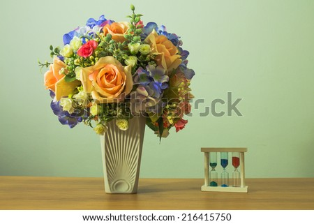 Still life with flowers and fruits on wooden table