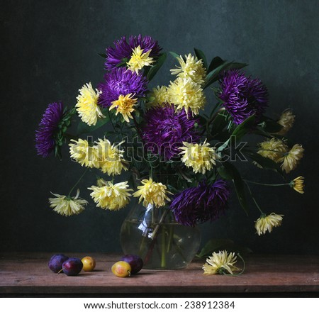 Still life with flowers and plums - stock photo