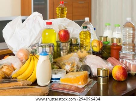 Still life with foodstuffs on  table in home - stock photo