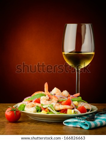 still life with fresh and healthy seafood prawns salad and wine
