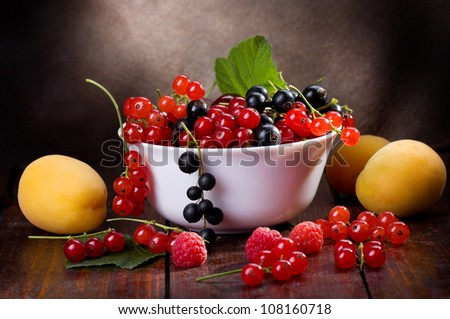 still life with fresh fruits and berries