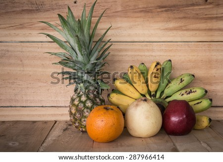 Still life with Fresh fruits  on wooden table - stock photo