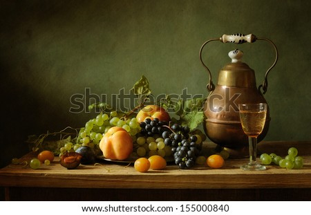 Still life with fruit and a tin jar - stock photo