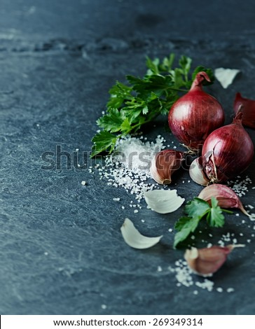 Still life with garlic, onion, parsley and sea salt  - stock photo