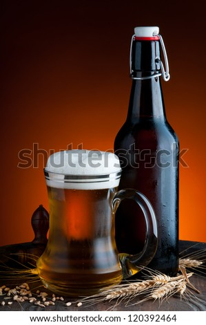 still life with glass and bottle of fresh beer
