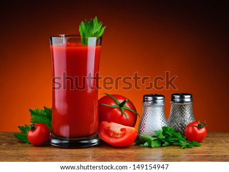still life with glass of fresh tomato juice, tomatoes, parsley, salt and pepper