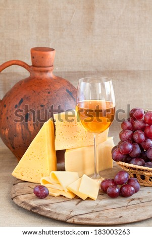 still life with grapes, cheese and wine
