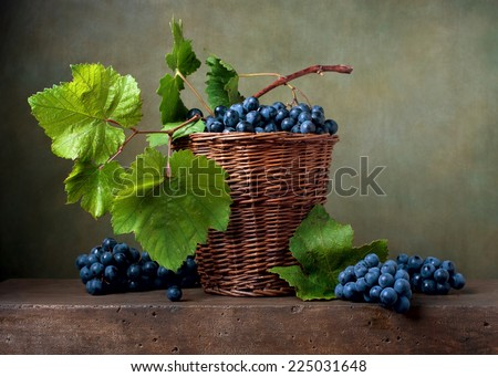 Still life with grapes in a basket