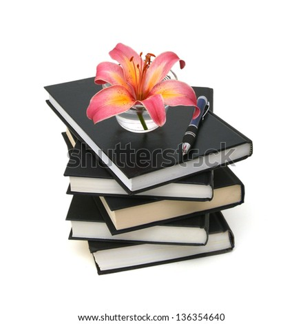 still life with huge bunch of spring lily and black books isolated on white background