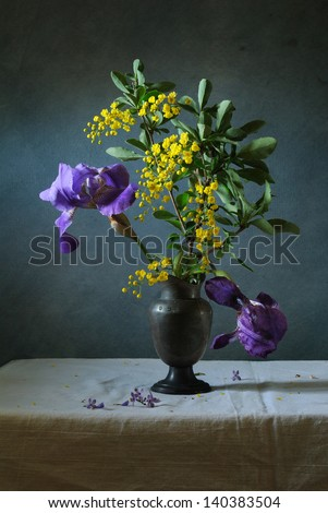 Still life with iris and barberries - stock photo