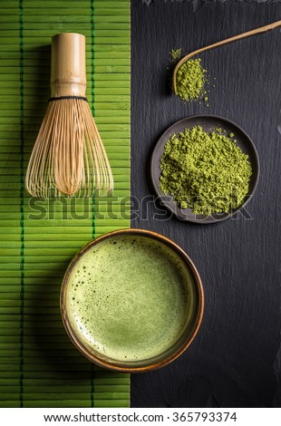 Still life with Japanese matcha accessories and green tea in bowl - stock photo
